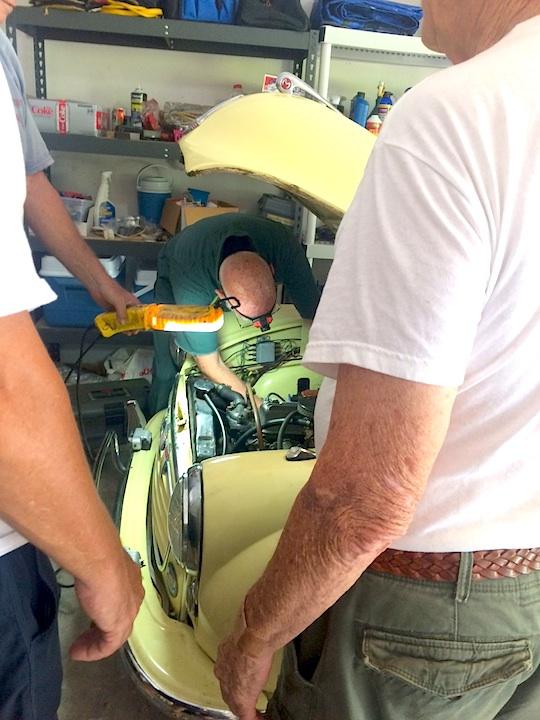 Photo of Patrick Casey working on Gary Bean's Morris.